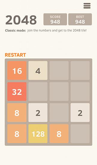 ▲要設法把相同數字的兩個方塊移到一起,一直加到2048出現為止(圖/手機截圖)